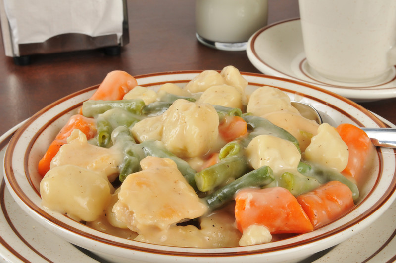 A bowl of chicken and dumplines