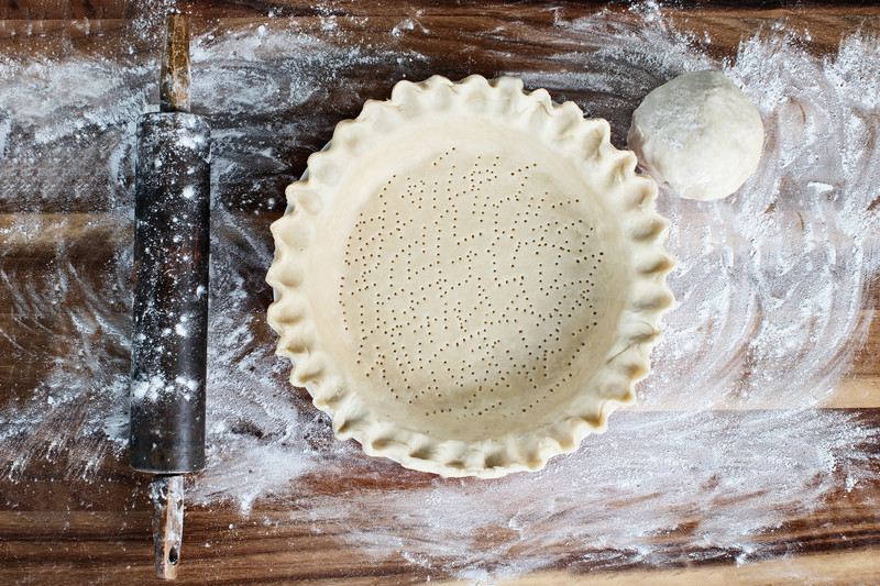 A photo of a freshly made pie crust ready to be filled.